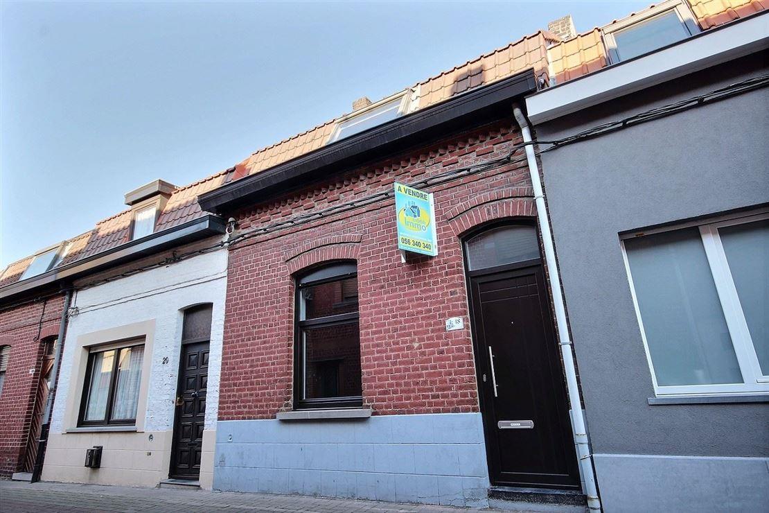 Jolie maison à rénover située dans une rue calme et proche de toutes commodités