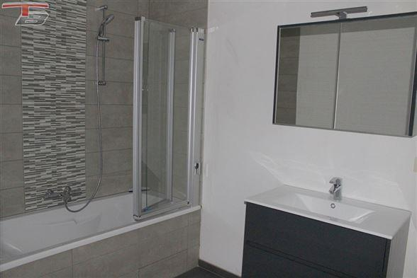 Duplex basse énergie neuf 3 chambres de 116m² garage et 2 terrasses bien exposées dans un environnement verdoyant