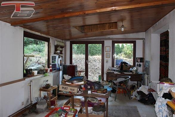 Bungalow à rénover sur terrain arboré de 1.200m² situé dans un cadre exceptionnel recherché calme et isolé