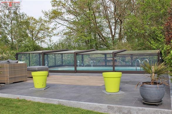 Belle propriété 4 chambres de 277m² avec piscine chauffée, garages et photovoltaïque sur terrain de 1.845m² située dans un écrin de verdure à proximité immédiate de Magnée
