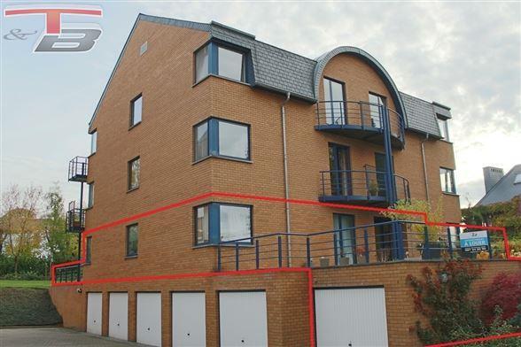 Rez-de-chaussée 2 chambres de 74 m² avec terrasses, cave, garage et parking individuels idéalement situé sur les hauteurs de Spa