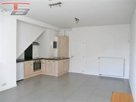 Rez-de-chaussée 1 chambre de 46m² en bon état idéalement situé dans le centre-ville