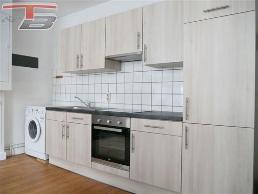 Spacieux appartement 1 chambre de 78m² situé à proximité immédiate du centre-ville