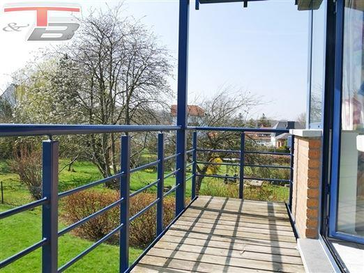 Appartement 2 chambres avec terrasse plein sud et garage situé dans un quartier calme et prisé proche du centre