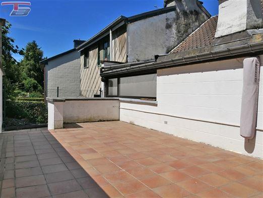 Maison 3 chambres avec terrasse et jardin bien orientés à proximité immédiate du centre ville.